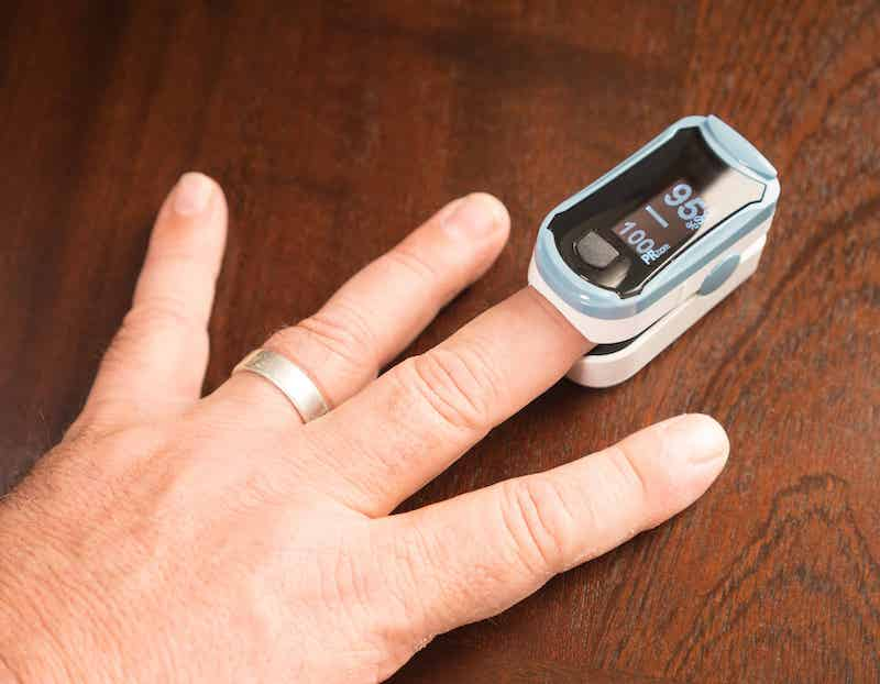 Close up of an oximeter on a finger